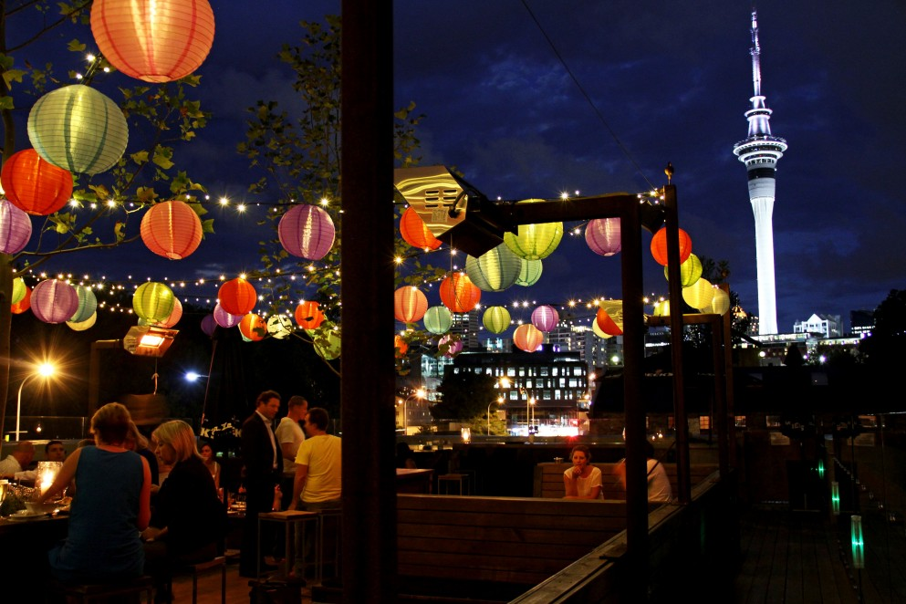 People sitting under lanterns