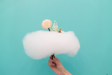 Hand holding a cloud of candy floss