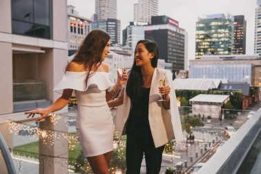 Ladies drinking on a balcony