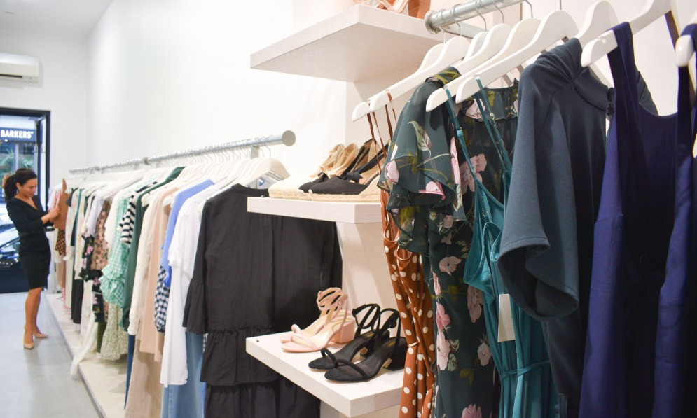 Womens clothing and shoes on display