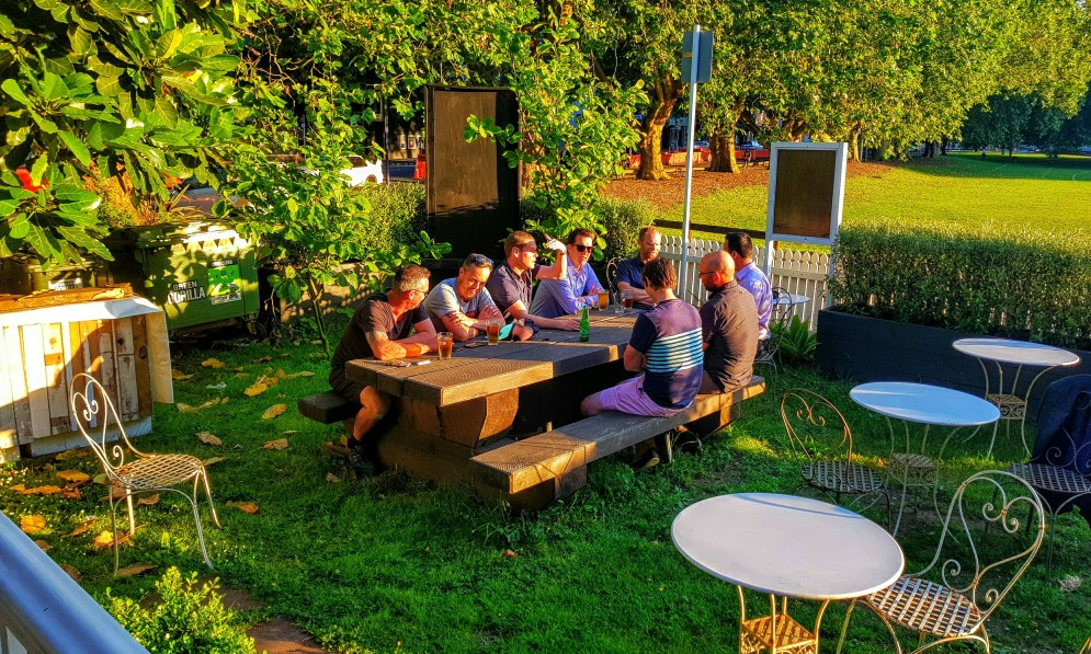 People drinking beer in a garden