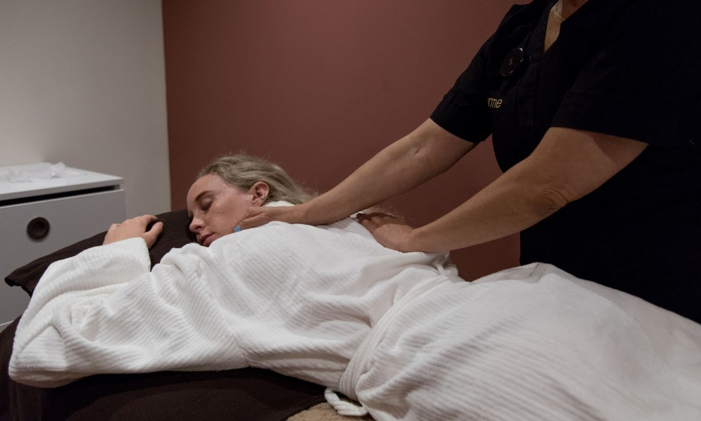 Client receiving back massage